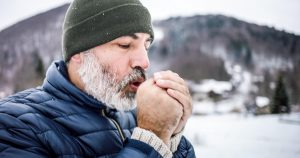 Mature man outdoors on a cold winter day