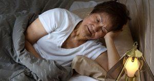 Sick woman in bed sleeping