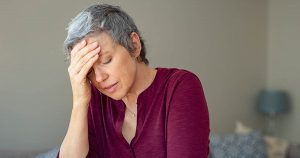 Frustrated woman at home