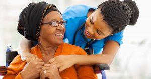 Caregiver is hugging her patient