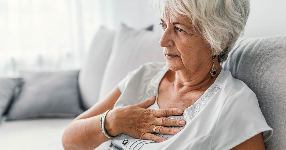 Senior woman suffering from chest discomfort