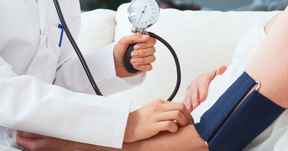 Doctor measuring patient's blood pressure levels