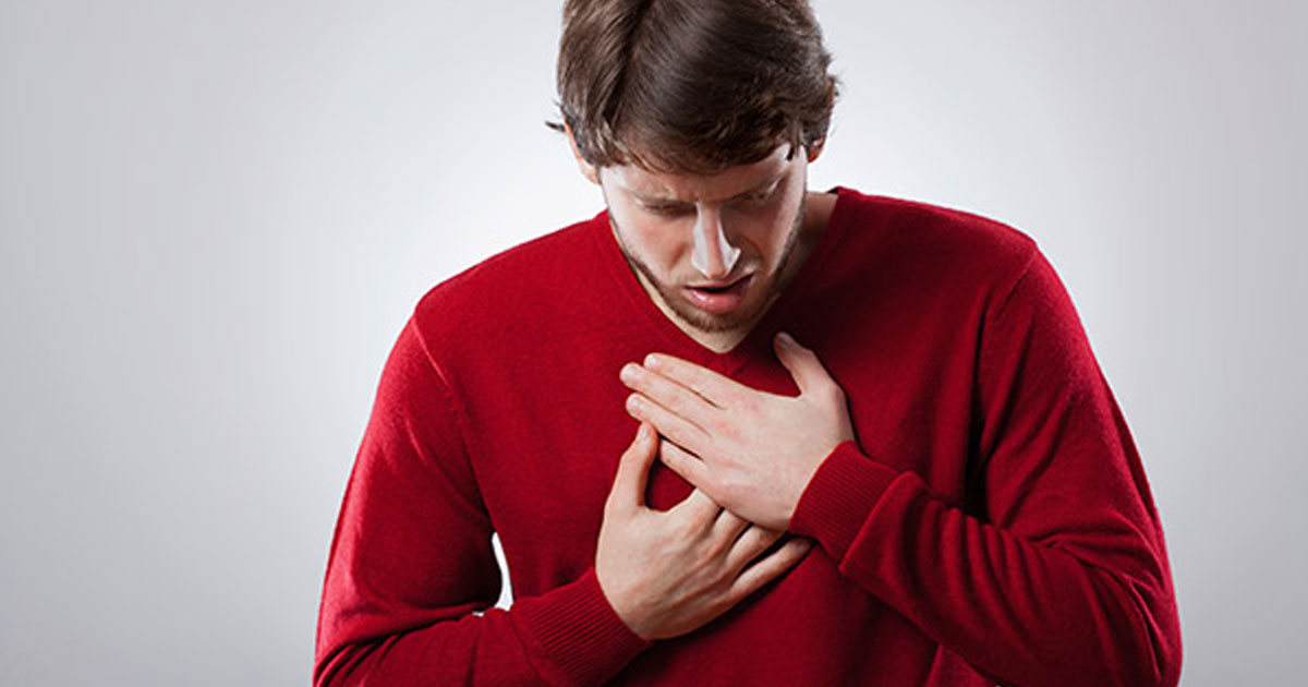 Man experiencing chest discomfort or pain