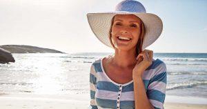 Mature woman enjoying a day at the beach