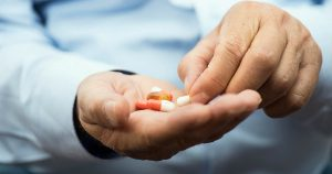 Person holding medications in hand