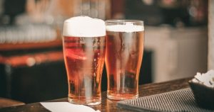 2 glasses of alcohol (beer)